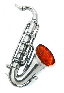 "Brooch ""Saxophone"" with cognac amber"