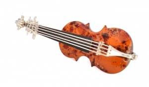 "Brooch ""Violin"" with cherry Amber"